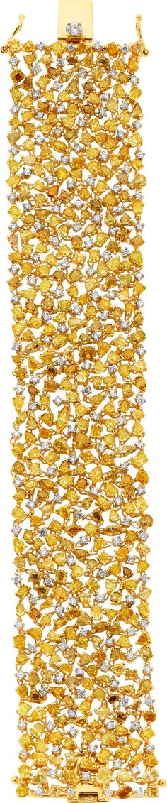 Fancy Yellow Diamond and Gold Bracelet.