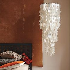 DIY Capiz Chandelier. Wax paper + an iron + thread + a lamp shade = beautiful CHEAP chandelier!