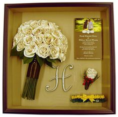 Shadowbox - neat idea to preserve bouquet, boutonniere and invitation.