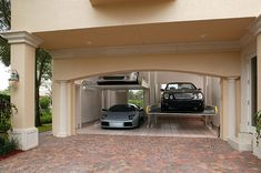Hydraulic lifts maximize space and turn your two-car garage into a four-car garage.