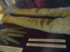 Queen Elizabeth I's knitted lace silk stockings at Hatfield House. Image from QunoSpotter, via Flickr.