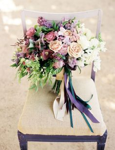 purple clematis, hellebores, sweet peas, quicksand roses, ranunculus, muscari and maiden hair fern bouquet by The Secret Garden