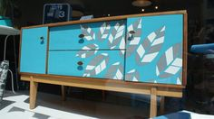 Sideboard customised by Lucy Turner using laser cut Formica laminate.