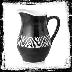 Serve your guests with this modish zebra striped pitcher. It's sure to spark conversation at your next party. #AnnasLinens #AnimalPrint