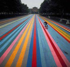 artist Gene Davis painting the street leading up to the Philadelphia Museum of Art in 1972