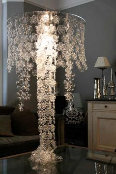 Can you believe this chandelier is made from plastic water bottle bottoms!?!?