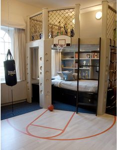 This is awesome! No-holds-barred dream space  - rock-climbing wall, a punching bag, a mini basketball court, and more. The circular cutouts are backed in Velcro and filled with removable ping-pong balls as part of the loft frames.