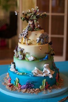 All kinds of animals on this children's multi tier cake.