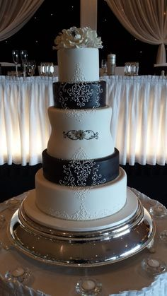 Black and white 5tier cake Hand piped scrolls.  Paul Delaney of Delaneys cakes