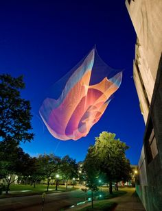 """Janet Echelman's 230-foot-long aerial sculpture """"1.26"""" suspends from the roof of the 7-story Denver Art Museum above downtown street traffic to commemorate the inaugural Biennial of the Americas. sculpture projects, artist"""