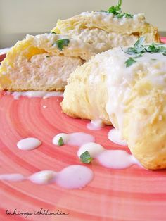 Chicken Pillows with Creamy Parmesan Sauce Recipe ~ the inside filling is warm and scrumptious, but the outside biscuit layer is crispy - with the parmesan sauce slathering every bite along the way