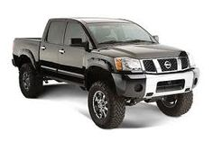 Nissan titan, 6 inch lift, bull par, tinted window...... Exactly what I want <3