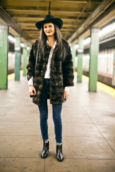 25 Snaps Of The Subway's Most Stylish Commuters #refinery29 http://www.refinery29.com/new-york-city-subway-street-style#slide7 Name: Catherine EschertJob: StudentWhat She's Wearing: MINKPINK shirt, 7 For All Mankind jeans, Lord + Taylor coat, Urban Outfitters hat, and jewelry from House of Harlow and Catbird.