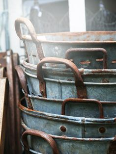 A selection of antique metal washbins.