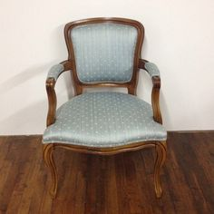 Stella blue chair: Blue upholstered armchair.