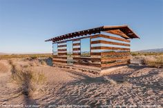 desert mirror house Lucid Stead cabin by Phillip K Smith III  The Lucid Stead began with a 70-year-old homesteader shack. Unused and out of place, Smith turned it into something magical by adding mirrors to make the structure look transparent. Read more: http://dornob.com/transparent-desert-shack-is-more-than-meets-the-eye/#ixzz2oXNXQqNG