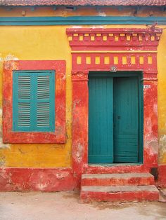 A colorful door to match a colorful house in Saint-Louis, Sénégal.  doors of the world. travel. Africa. exterior paint colors.