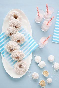 I'd be tempted to serve these delightful Coconut Doughnuts with pineapple juice in a nod to pina colada everywhere :) #doughnuts #donuts #coconut #food #desserts
