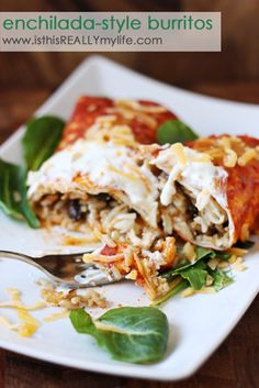 Enchilada-style burritos--so easy and you can freeze the extra pan! Uses Zatarain's Dirty Rice mix, chicken and whatever else you want to throw in (black beans, green chilies). Add a little enchilada sauce and cheese and you're golden!