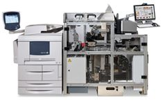 """""""Espresso Book Machine: Books Printed In Minutes At Point Of Sale For Immediate Pick Up Or Delivery"""" -- find a list of locations here: http://en.wikipedia.org/wiki/Espresso_Book_Machine#Locations"""