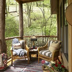 Natural Woodland Porch     Outdoor furniture rests comfortably on this back porch. This durable design blends with indoor decor, such as the Tiffany lamp and rag rugs made from recycled blue jeans. Quilts are at the ready for chilly evenings. Bedroom windows open onto this serene space to catch the sound of Whisper Creek.                            Outdoor furniture rests comfortably on this back porch. This durable design blends with ...