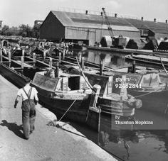 "Captioned: ""Awaiting loading at #Brentford""  #canal #dock #interchange #transhipment #barge #narrowboat #british #waterways #grand #union #crane #warehouse #london"