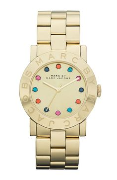 fun gold watch with a hint of color