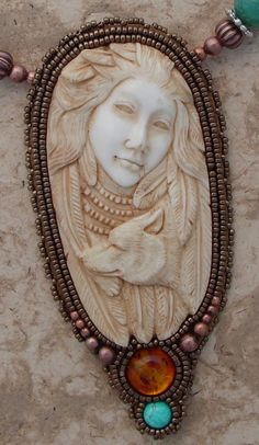 Bone Carved Women and Wolf Necklace by freespiritheidi on Etsy