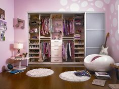 girl's room- love the fun chair, the paint, and the open closet.  the rugs are great, too!