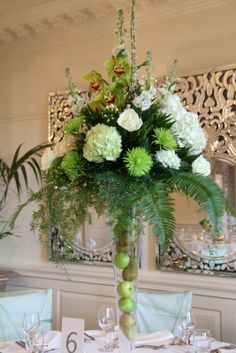 The taller designs were in our tall designer vases filled with fresh fruit and topped with fresh Almond Blossom, Roses, Stocks, Hydrangeas, Roses, Cymbidium Orchids, Shamrock and Bouvardia