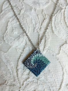 Midnight Seafoam Wave Mosaic Necklace - polymer clay pendant - with chain. $15.00, via Etsy.
