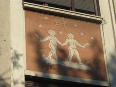 """GEMINI THE TWINS. Zodiac Building, Bucharest. And an astropoem: Two beautiful stars / and the Geminid meteor shower / which annually announces that / Castor and Pollux / have remained Olympic champions / in the heavens.  (Image & poem: Andrei Dorian Gheorghe) Mona Evans, """"Gemini - the Celestial Twins"""" http://www.bellaonline.com/articles/art182821.asp"""