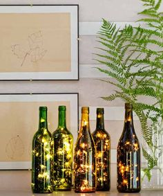 Use Wine Bottles to Create a Festive Light Display~Feed a 50-light string (get the kind with just one plug) into a hole drilled in a bottle's side. We used a ¾-inch tile bit, then enlarged and smoothed the hole with a conical grinding stone.