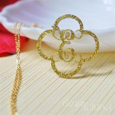 quatrefoil initial monogram acrylic necklace. $14.00, via Etsy.