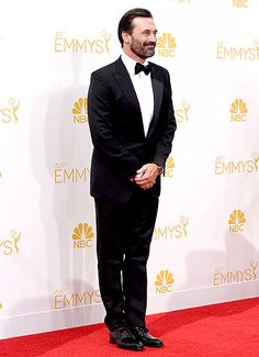 Jon Hamm looked modern and sleek in a Tom Ford black peak lapel tuxedo, bow tie and patent shoes at the 2014 Emmys.