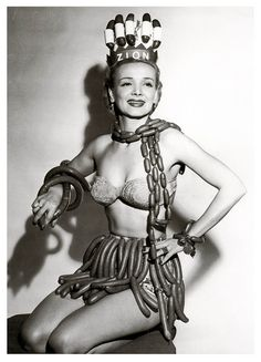 Geene Courtney, Sausage Queen  Sponsored by the Zion Meat Company during National Hot Dog Week, 1955.  Afterwards the giggles followed her to the grave