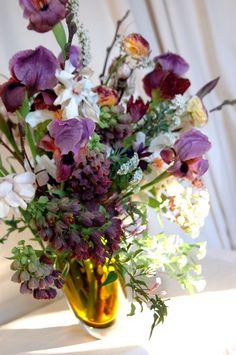 Early Spring flower arrangement with Peonies, Magnolia, Frittiliaria, Jasmine, Parrot tulips,Ranunculus,Bearded Iris and Viburnum