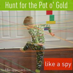 Our twist on a pot o' gold hunt. We set up a spy course with yarn and tried to make it through it to get to the gold! Loads of fun while moving and learning. Do you ever create obstacle courses for your kids?