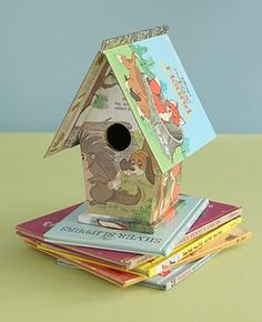 Birdhouse from old books - decoupage the body of a craft store bird house with book pages and glue the cover over the roof. Cute!