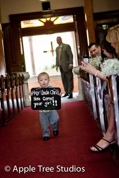 """Saw this at a wedding! When the wedding was over the ring bearer flipped the sign over and it said """"now let's party!"""" such a cute idea!!"""
