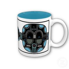 """African Pop (Ceramic Mug) - What do you get when you take a traditional African Tribal Mask & paint it w/ the latest colors for spring 2013 (colors that were also popular in the late 1950's early 1960's)? This fun """"African Pop"""" design as re-imagined by digital artist, Leslie Sigal Javorek. Black, medium blue, aqua, mauve, pinkish-gray & olive gray. Your choice of mug style & size. See cooordinating dishes & table linens @ www.zazzle.com/homearts/african+gifts?rf=238155573613991097"""