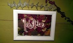 shadow box filled with dry flowers