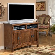 "Signature Design by Ashley Castle Hill 42"" TV Stand (approved) - would more or less match our hutch"