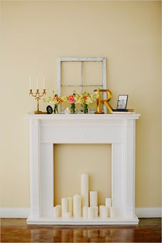 Build it yourself fire place :) Cute set-up even for houses that already have a fireplace. Candles instead of logs.
