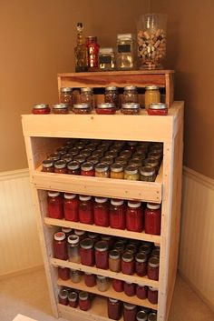 Canning pantry made from recycled pallets. It holds over 200 quarts & pints!