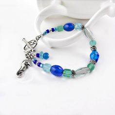Beachy Aqua and Blue Bracelet Summer Fashion by ReneeBrownsDesigns, #handmade #jewelry #beaded #bracelet #blue #aqua #seahorse #ocean #beach #sea