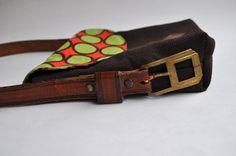 Old belt as bag strap.  cute!