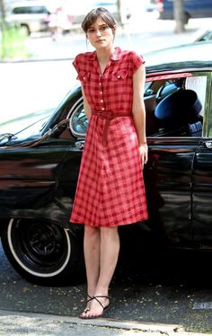 Keira Knightley in a fun plaid dress and flat sandals