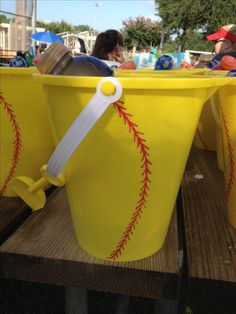 Softball buckets.  Had to make a gift to exchange with other team we played at softball tournament.  Yellow buckets from dollar store with softball treads painted on it.  Loaded with sunscreen,  fan and Gatorade.  Things representing Florida.  Exchanged with other team from out of state. Perfect for tournaments, parties or team gifts.  Thanks to janelle Colby!