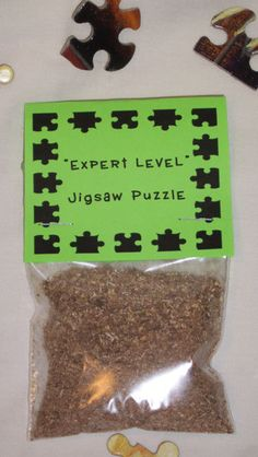 Gag Gift Expert Level Jigsaw Puzzle Novelty Link goes to etsy site, but the picture is pretty self-explanatory.